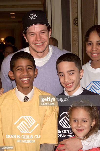 Mark Wahlberg with members of the Boys Girls Club at the launch of Campaign 3 PM at the WaldorfAstoria Hotel in New York City The campaign is part of...