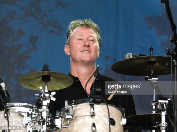 Mark Walker drummer with English progressive and psychedelic rock band Caravan performs live on stage at Cropredy Festival in Banbury