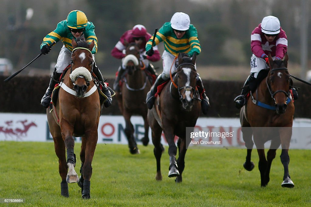 Mark Walsh riding Coney Island (L) clear the last to win The Bar One Racing Drinmore Novice Chase at Fairyhouse racecourse on December 4, 2016 in Dublin.