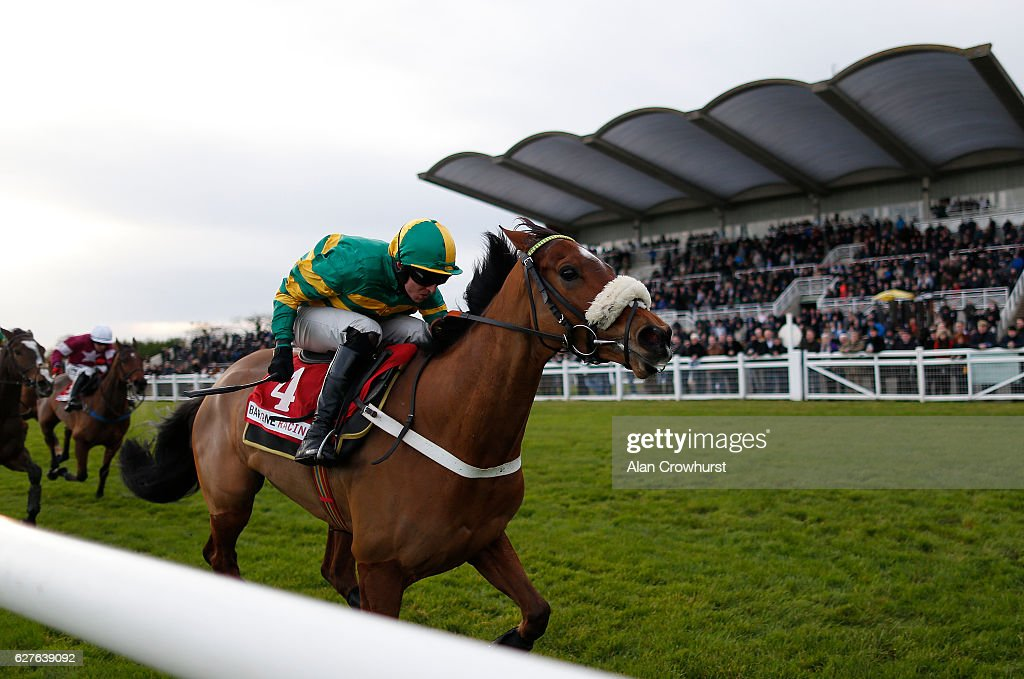 Mark Walsh riding Coney Island clear the last to win The Bar One Racing Drinmore Novice Chase at Fairyhouse racecourse on December 4, 2016 in Dublin.