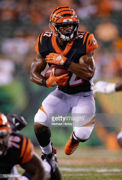 Mark Walton of the Cincinnati Bengals runs the ball against the Indianapolis Colts during a preseason game at Paul Brown Stadium on August 30 2018 in...