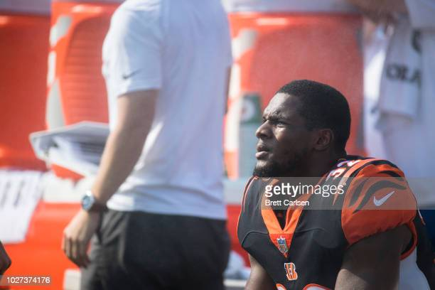 Mark Walton of the Cincinnati Bengals sits on the bench watching game action during the preseason game against the Buffalo Bills at New Era Field on...