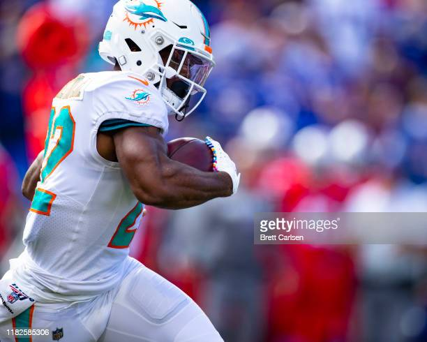 Mark Walton of the Miami Dolphins carries the ball during the first quarter against the Buffalo Bills at New Era Field on October 20 2019 in Orchard...