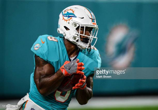 Mark Walton of the Miami Dolphins in action during the preseason game against the Jacksonville Jaguars at Hard Rock Stadium on August 22 2019 in...