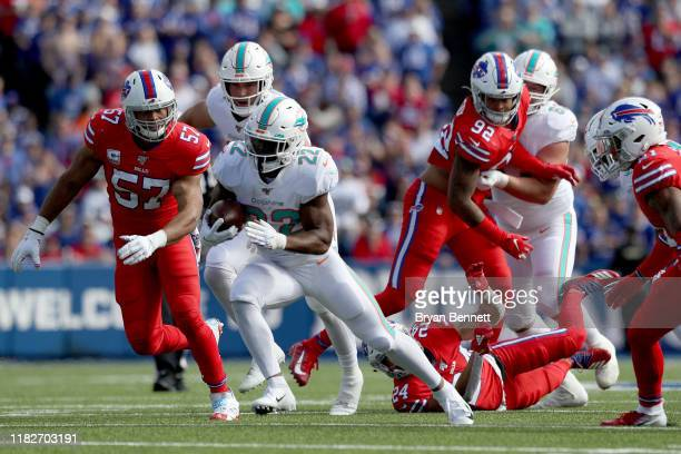 Mark Walton of the Miami Dolphins runs the ball during the first half of an NFL game against the Buffalo Bills at New Era Field on October 20 2019 in...