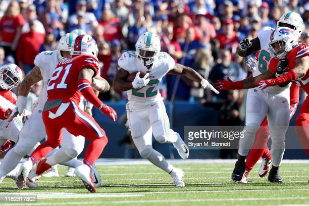 Mark Walton of the Miami Dolphins runs the ball during the fourth quarter of an NFL game against the Buffalo Bills at New Era Field on October 20...