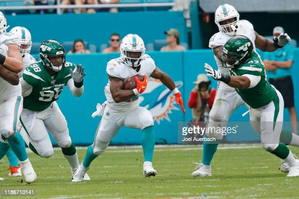 Mark Walton of the Miami Dolphins runs with the ball against the New York Jets during an NFL game on November 3 2019 at Hard Rock Stadium in Miami...