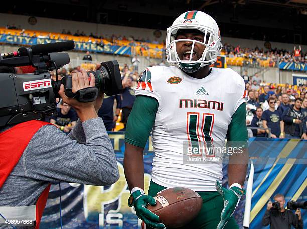 Mark Walton of the Miami Hurricanes celebrate after 22 yard touchdown pass in the first half during the game against the Pittsburgh Panthers on...