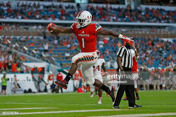 Mark Walton of the Miami Hurricanes celebrates after scoring a second quarter touchdown against the Florida Atlantic Owls on September 10 2016 at...