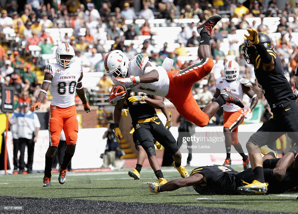 Mark Walton #1 of the Miami Hurricanes dives into the endzone for a touchdown against the Appalachian State Mountaineers during their game at Kidd Brewer Stadium on September 17, 2016 in Boone, North Carolina.