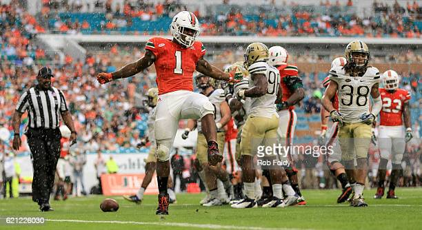 Mark Walton of the Miami Hurricanes gestures after a play during the first half of the game against the Pittsburgh Panthers at Hard Rock Stadium on...