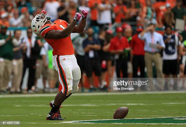 Mark Walton of the Miami Hurricanes reacts to a play during a game against the North Carolina Tar Heels at Hard Rock Stadium on October 15 2016 in...