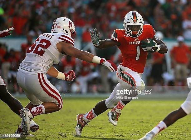 Mark Walton of the Miami Hurricanes rushes during a game against the Nebraska Cornhuskers at Sun Life Stadium on September 19 2015 in Miami Gardens...