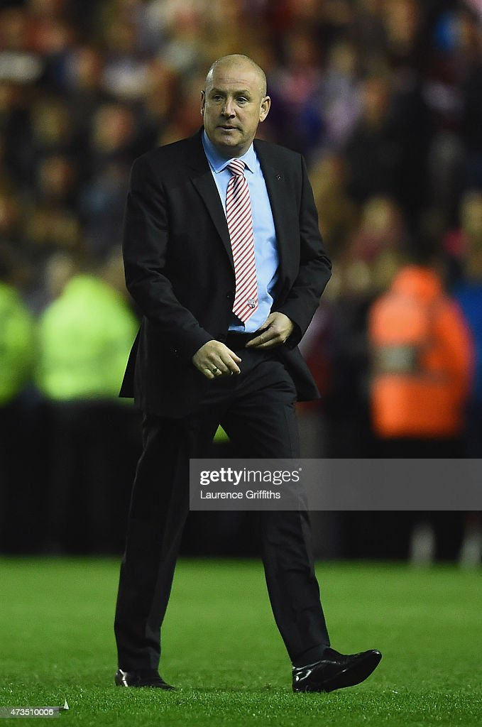 Mark Warburton manager of Brentford looks on after defeat in the Sky Bet Championship Playoff semi final second leg match between Middlesbrough and Brentford at the Riverside Stadium on May 15, 2015 in Middlesbrough, England. Boro won the match 3-0 and 5-1 on aggregate.
