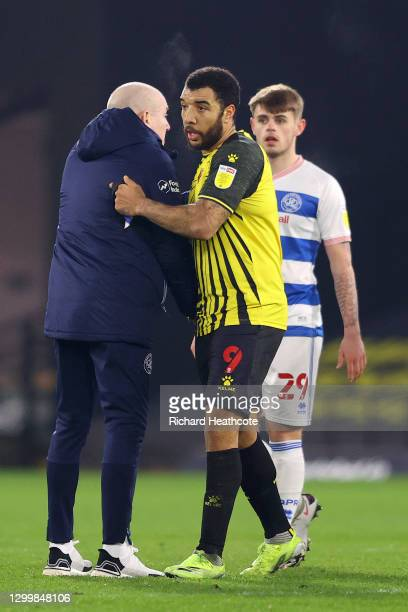 Mark Warburton, Manager of Queens Park Rangers embraces Troy Deeney of Watford FC after the Sky Bet Championship match between Watford and Queens...