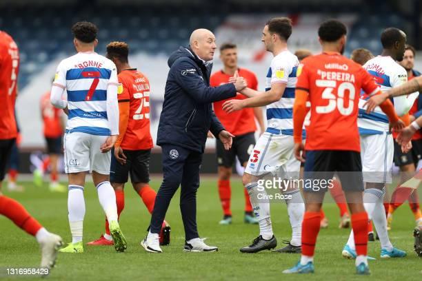 Mark Warburton, Manager of Queens Park Rangers interacts with Lee Wallace of Queens Park Rangers following the Sky Bet Championship match between...