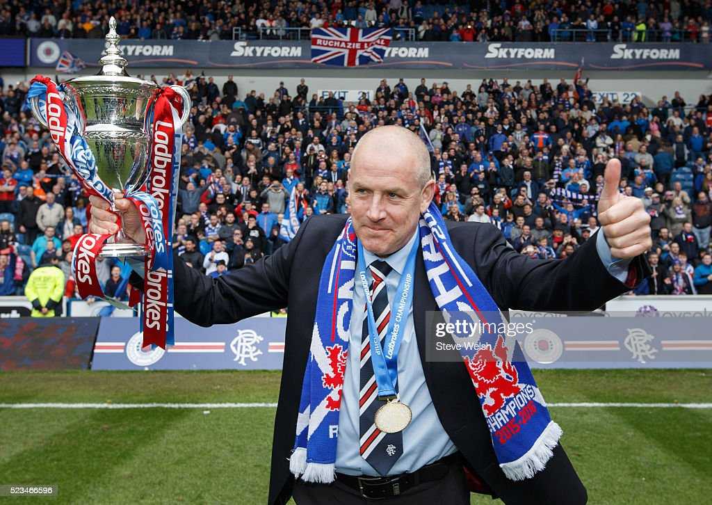 Mark Warburton Rangers manager lifts the Scottish Championship Trophy after the Scottish Championship match between Rangers and Alloa Athletic Scottish at Ibrox Stadium April 23, 2016 in Glasgow, United Kingdom.