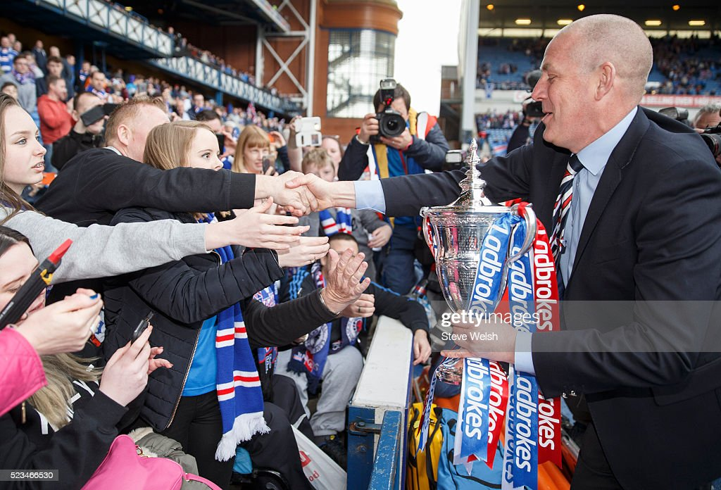 Mark Warburton Rangers manager takes the Scottish Championship Trophy to the waiting fans after the Scottish Championship match between Rangers and Alloa Athletic Scottish at Ibrox Stadium April 23, 2016 in Glasgow, United Kingdom.