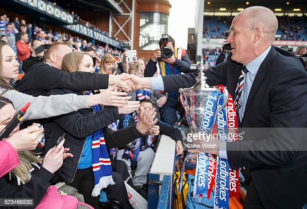Mark Warburton Rangers manager takes the Scottish Championship Trophy to the waiting fans after the Scottish Championship match between Rangers and...