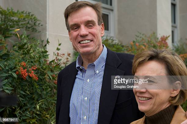 Mark Warner and his wife Lisa Collis arrives to vote on November 4th 2008 at Lyles Crouch School in Alexandria Virginia