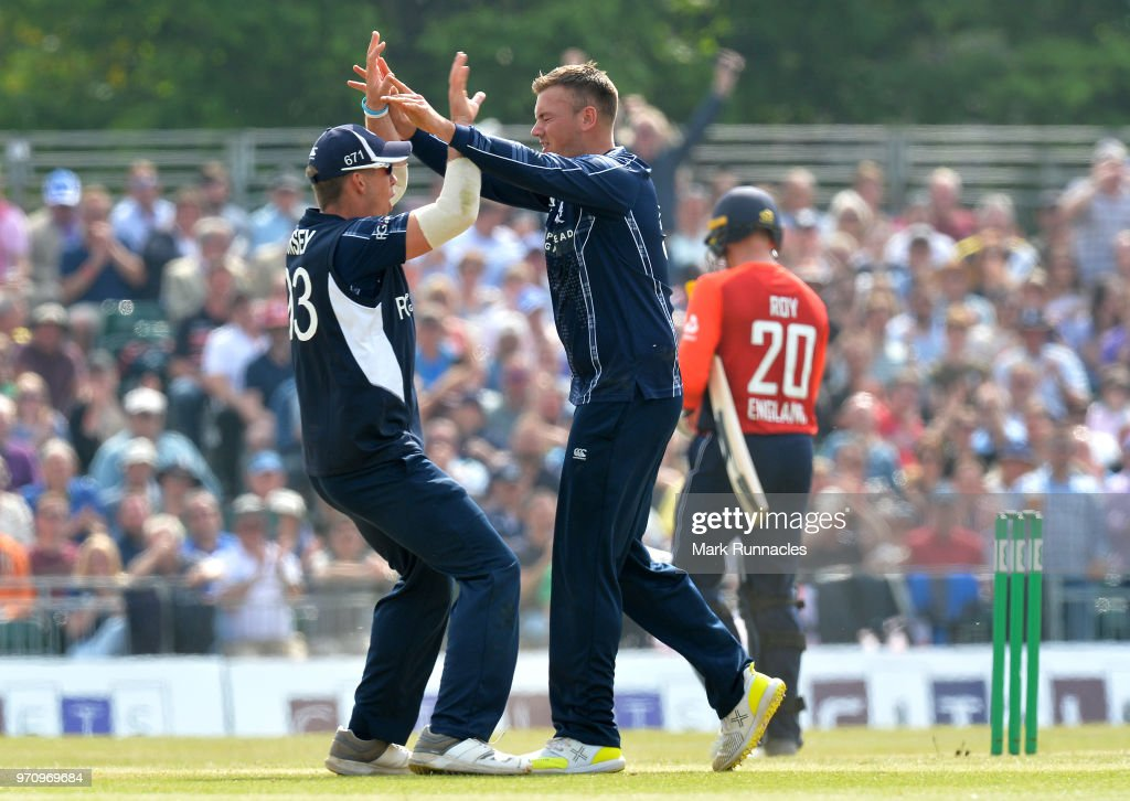 Mark Watt of Scotland celebrates taking the wicket of Jason Roy of England during the One Day International match between Scotland and England at The Grange on June 10, 2018 in Edinburgh, Scotland.