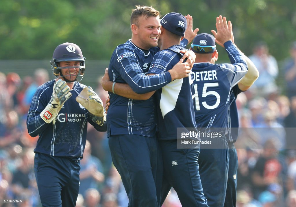 Mark Watt of Scotland celebrates with his team mates after taking the wicket of Sam Billings of England during the One Day International match between Scotland and England at The Grange on June 10, 2018 in Edinburgh, Scotland.