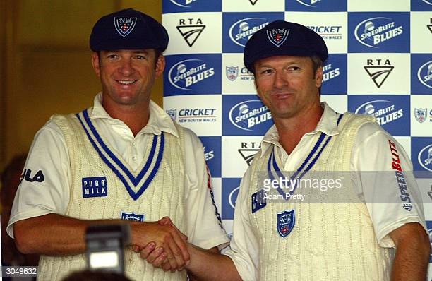 Mark Waugh and Steve Waugh of the Blues shake hands after being presented with commorative caps to mark the end of their cricketing careers during...