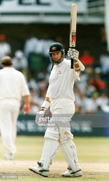 Mark Waugh of Australia celebrates after reaching a half century during the 2nd Test Match between South Africa and Australia March 14 1997 in Port...