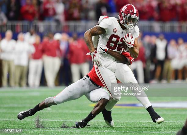 Mark Webb of the Georgia Bulldogs attempts to tackle Irv Smith Jr #82 of the Alabama Crimson Tide in the second half during the 2018 SEC Championship...