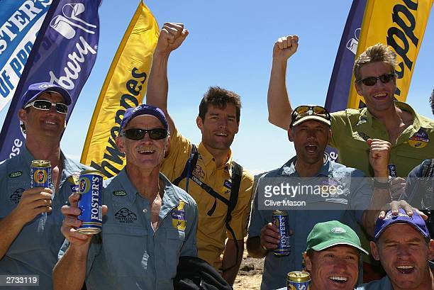 Mark Webber James Tompkins and Bernie Shrosbree celebrate at the finish of The Cadbury Schweppes Mark Webber Challenge November 16 2003 in Tasmania...