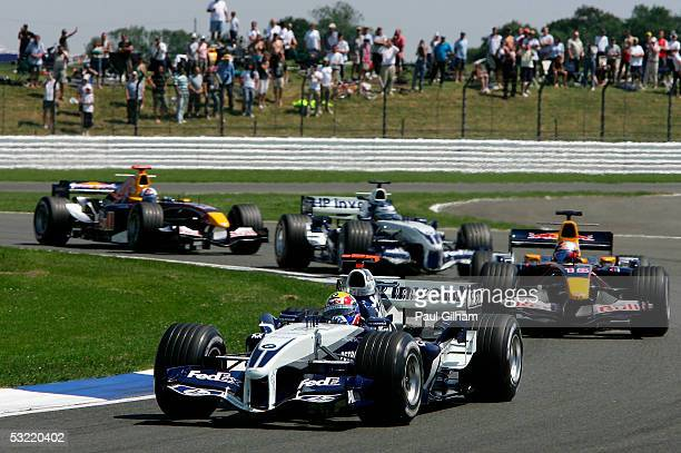 Mark Webber of Australia and BMW Williams leads Christian Klien of Austria and Red Bull during the British F1 Grand Prix at Silverstone Circuit on...