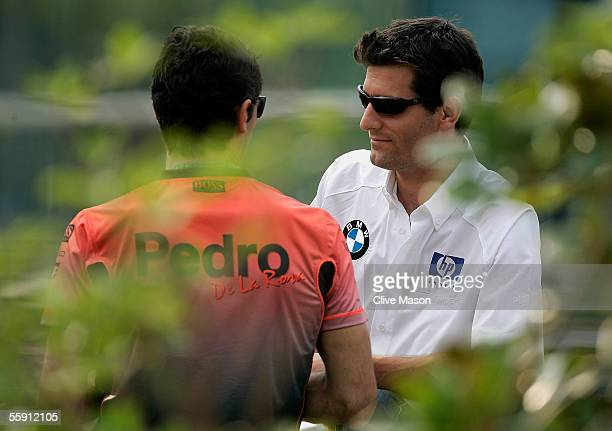 Mark Webber of Australia and BMW Williams talks to Pedro de la Rosa of Spain and McLaren Mercedes in the paddock during the previews to the Chinese...