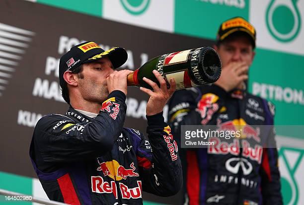 Mark Webber of Australia and Infiniti Red Bull Racing celebrates finishing second as race winner Sebastian Vettel of Germany and Infiniti Red Bull...