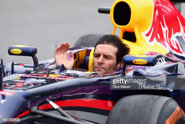 Mark Webber of Australia and Infiniti Red Bull Racing celebrates on his way to parc ferme after finishing second in his final F1 race following the...