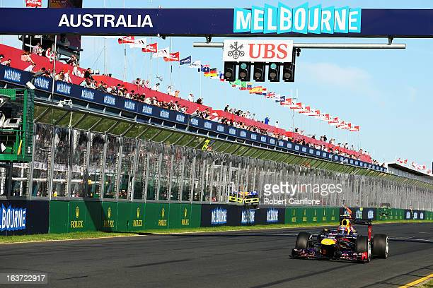 Mark Webber of Australia and Infiniti Red Bull Racing drives during practice for the Australian Formula One Grand Prix at the Albert Park Circuit on...