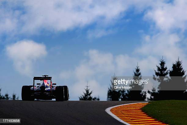 Mark Webber of Australia and Infiniti Red Bull Racing drives during practice for the Belgian Grand Prix at Circuit de SpaFrancorchamps on August 23...