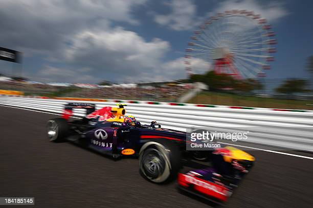 Mark Webber of Australia and Infiniti Red Bull Racing drives during the final practice session prior to qualifying for the Japanese Formula One Grand...