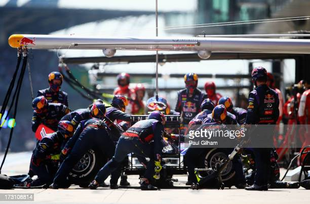 Mark Webber of Australia and Infiniti Red Bull Racing drives in for a pitstop during the German Grand Prix at the Nuerburgring on July 7, 2013 in...