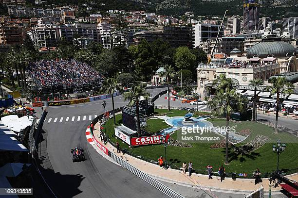Mark Webber of Australia and Infiniti Red Bull Racing drives through Casino Square during practice for the Monaco Formula One Grand Prix at the...