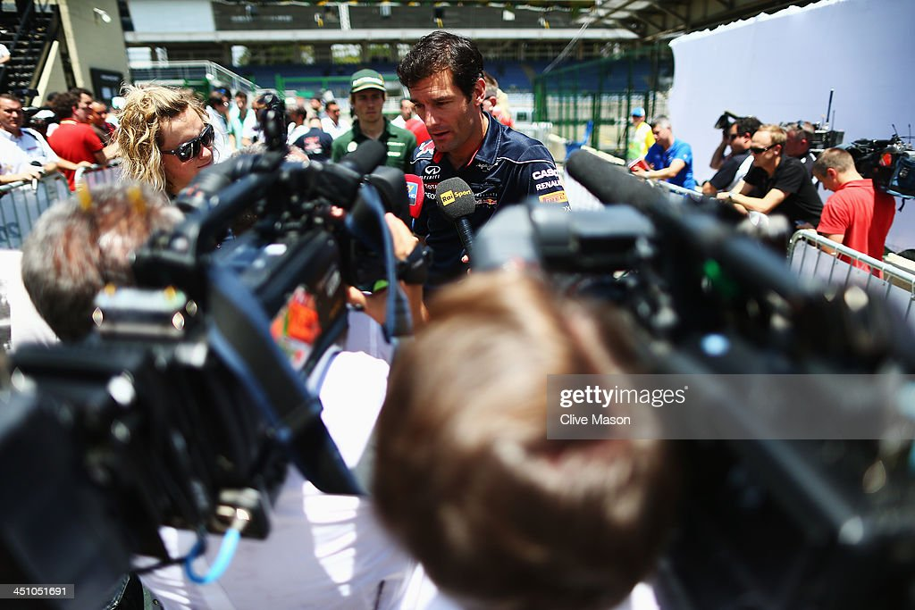 Mark Webber of Australia and Infiniti Red Bull Racing is interviewed by the media after attending his final drivers press conference during previews for the Brazilian Formula One Grand Prix at Autodromo Jose Carlos Pace on November 21, 2013 in Sao Paulo, Brazil. Webber is leaving Formula One at the end of this season to join Porsche in the World Endurance Championship.
