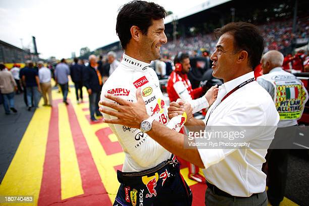 Mark Webber of Australia and Infiniti Red Bull Racing meets former Formula One driver Jean Alesi on the starting grid prior to the Italian Formula...