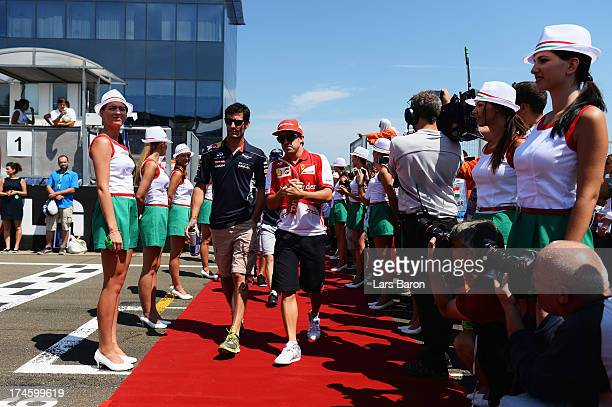 Mark Webber of Australia and Infiniti Red Bull Racing talks with Fernando Alonso of Spain and Ferrari during the drivers parade before the Hungarian...