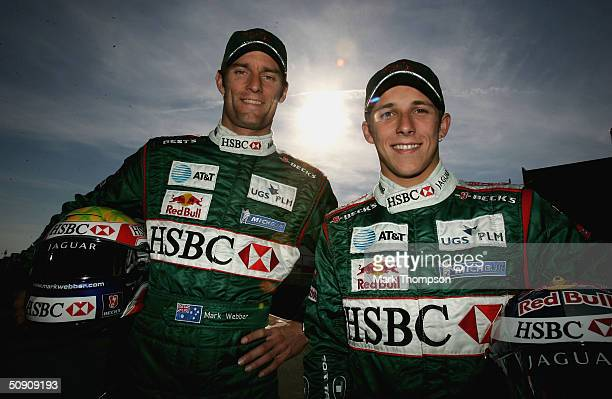 Mark Webber of Australia and Jaguar alongside Christian Klien of Austria and Jaguar in the paddock after qualifying for the European F1 Grand Prix on...