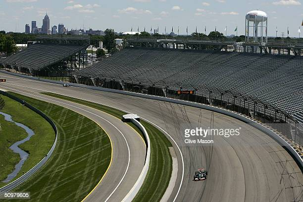Mark Webber of Australia and Jaguar in action during the United States F1 Grand Prix at the Indianapolis Motor Speedway Circuit on June 20 in...