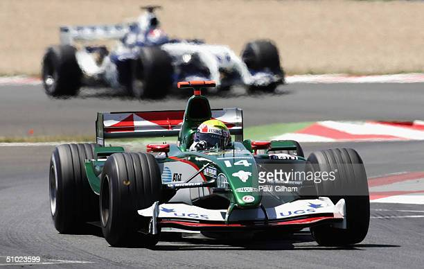 Mark Webber of Australia and Jaguar leads Marc Gene of Spain and BMW Williamsduring the French F1 Grand Prix at the Magny-Cours Circuit on July 4 in...