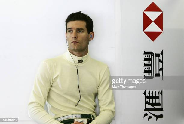 Mark Webber of Australia and Jaguar watches qualifying for the Formula One Chinese Grand Prix at Shanghai International Circuit on September 25, 2004...