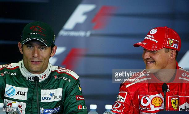 Mark Webber of Australia and Jaguar with Michael Schumacher of Germany and Ferrari talk to the press after they both made the front of the starting...