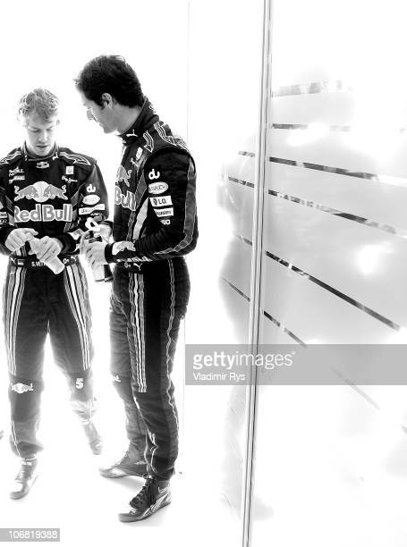 Mark Webber of Australia and Red Bull Racing and his team mate Sebastian Vettel of Germany are pictured ahead the Abu Dhabi Formula One Grand Prix at...