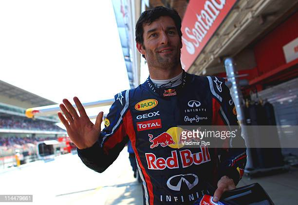 Mark Webber of Australia and Red Bull Racing celebrates after finishing first during qualifying for the Spanish Formula One Grand Prix at the Circuit...