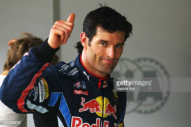 Mark Webber of Australia and Red Bull Racing celebrates in parc ferme after finishing first during qualifying for the Turkish Formula One Grand Prix...